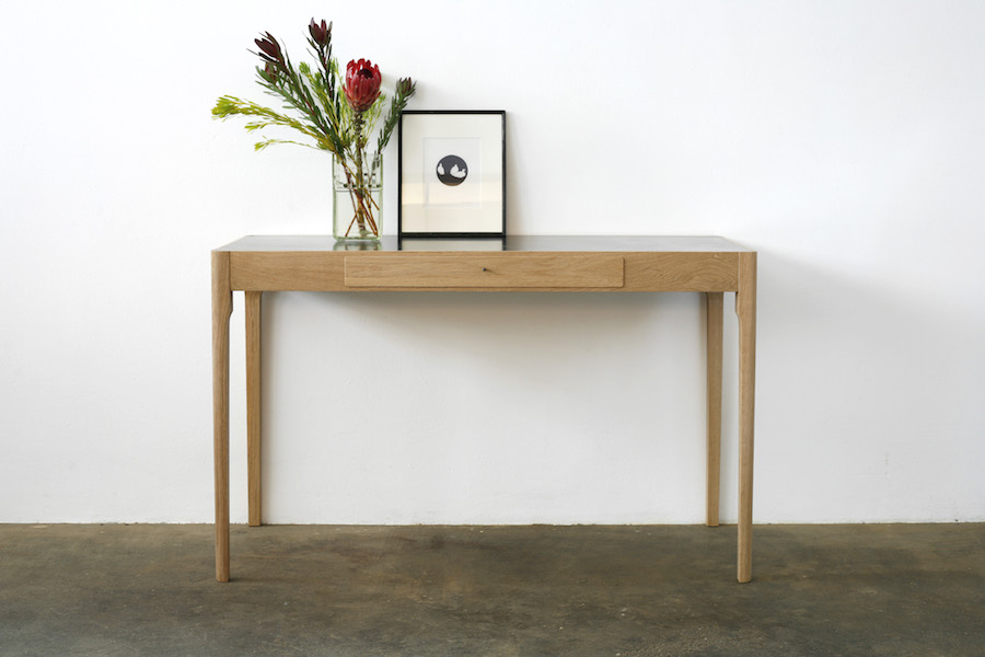 http://jamesmudge.com/files/gimgs/1_brass-top-tapered-leg-table.jpg
